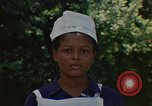 Image of Jamaican nurse Jamaica, 1972, second 9 stock footage video 65675040561