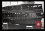 Image of Immigrants arriving at Ellis Island New York City USA, 1903, second 7 stock footage video 65675040610