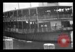 Image of Immigrants arriving at Ellis Island New York City USA, 1903, second 8 stock footage video 65675040610