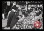 Image of Pushcart vendors New York City USA, 1903, second 6 stock footage video 65675040618
