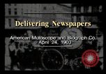 Image of Delivering newspapers New York City USA, 1903, second 3 stock footage video 65675040619