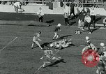 Image of Football match College Park Maryland USA, 1951, second 12 stock footage video 65675040663