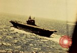 Image of Navy fighter aircraft landing on USS Essex Pacific Theater, 1945, second 10 stock footage video 65675040813
