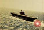 Image of Navy fighter aircraft landing on USS Essex Pacific Theater, 1945, second 11 stock footage video 65675040813