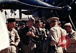 Image of US Army fliers look at various airplanes on airfield Kumming China, 1942, second 2 stock footage video 65675040867