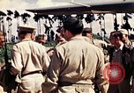 Image of US Army fliers look at various airplanes on airfield Kumming China, 1942, second 5 stock footage video 65675040867
