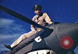 Image of US Army fliers look at various airplanes on airfield Kumming China, 1942, second 9 stock footage video 65675040867