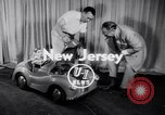 Image of Charlie McCarthy driving a car Princeton New Jersey USA, 1953, second 4 stock footage video 65675041357