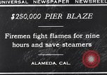 Image of pier blaze Alameda California USA, 1929, second 4 stock footage video 65675041387