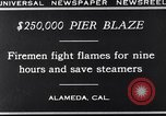 Image of pier blaze Alameda California USA, 1929, second 9 stock footage video 65675041387