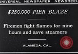 Image of pier blaze Alameda California USA, 1929, second 10 stock footage video 65675041387