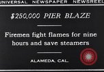 Image of pier blaze Alameda California USA, 1929, second 12 stock footage video 65675041387