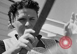 Image of Louella Gallagher knife throwing stunt Austin Texas USA, 1950, second 7 stock footage video 65675041468