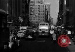 Image of crowded Fifth Avenue New York  New York City USA, 1940, second 11 stock footage video 65675041739
