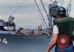 Image of USS Pollux unrep of USS Constellation Gulf of Tonkin Vietnam, 1967, second 4 stock footage video 65675042001