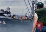 Image of USS Pollux unrep of USS Constellation Gulf of Tonkin Vietnam, 1967, second 6 stock footage video 65675042001