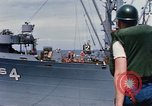 Image of USS Pollux unrep of USS Constellation Gulf of Tonkin Vietnam, 1967, second 9 stock footage video 65675042001