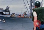 Image of USS Pollux unrep of USS Constellation Gulf of Tonkin Vietnam, 1967, second 10 stock footage video 65675042001