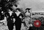 Image of Three women strolling in a park Paris France, 1907, second 6 stock footage video 65675042050