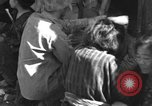 Image of injured Japanese children Okinawa Ryukyu Islands, 1945, second 1 stock footage video 65675042089