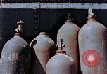 Image of storage tank Hiroshima Japan, 1946, second 12 stock footage video 65675042131