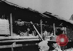 Image of house on fire China, 1945, second 11 stock footage video 65675042298