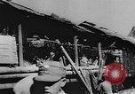 Image of house on fire China, 1945, second 12 stock footage video 65675042298
