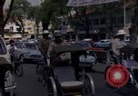 Image of cyclos Saigon Vietnam, 1964, second 6 stock footage video 65675042319