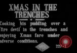Image of British soldiers sharing Christmas pudding in trenches France, 1916, second 5 stock footage video 65675042463