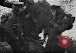 Image of British soldiers sharing Christmas pudding in trenches France, 1916, second 8 stock footage video 65675042463