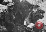 Image of British soldiers sharing Christmas pudding in trenches France, 1916, second 10 stock footage video 65675042463