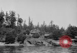 Image of Puget Sound coastline in early 1900s Tacoma Washington USA, 1917, second 5 stock footage video 65675042499