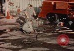Image of American airmen in firehouse at airbase Takhli Thailand, 1964, second 3 stock footage video 65675042581