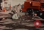 Image of American airmen in firehouse at airbase Takhli Thailand, 1964, second 5 stock footage video 65675042581