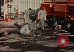 Image of American airmen in firehouse at airbase Takhli Thailand, 1964, second 7 stock footage video 65675042581