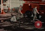Image of American airmen in firehouse at airbase Takhli Thailand, 1964, second 10 stock footage video 65675042581