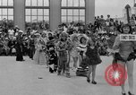 Image of American children parade in costume Ocean Park California USA, 1935, second 2 stock footage video 65675042765