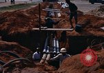Image of laying pipes Thailand, 1966, second 5 stock footage video 65675042838