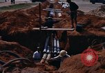 Image of laying pipes Thailand, 1966, second 6 stock footage video 65675042838