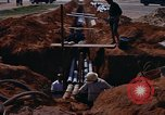Image of laying pipes Thailand, 1966, second 7 stock footage video 65675042838