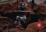 Image of laying pipes Thailand, 1966, second 10 stock footage video 65675042838