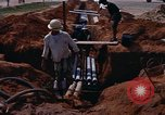 Image of laying pipes Thailand, 1966, second 12 stock footage video 65675042838