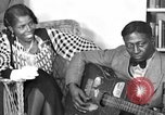 Image of Lead Belly United States USA, 1936, second 1 stock footage video 65675042896