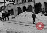 Image of shoveling snow Bludenz Austria, 1954, second 7 stock footage video 65675042927