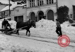 Image of shoveling snow Bludenz Austria, 1954, second 9 stock footage video 65675042927