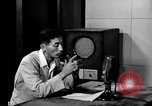 Image of Japanese Station announcer Tokyo Japan, 1945, second 6 stock footage video 65675043008