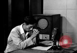 Image of Japanese Station announcer Tokyo Japan, 1945, second 7 stock footage video 65675043008
