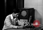 Image of Japanese Station announcer Tokyo Japan, 1945, second 12 stock footage video 65675043008