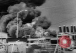 Image of Oil company warehouse under fire San Juan Puerto Rico, 1967, second 7 stock footage video 65675043046
