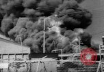 Image of Oil company warehouse under fire San Juan Puerto Rico, 1967, second 9 stock footage video 65675043046
